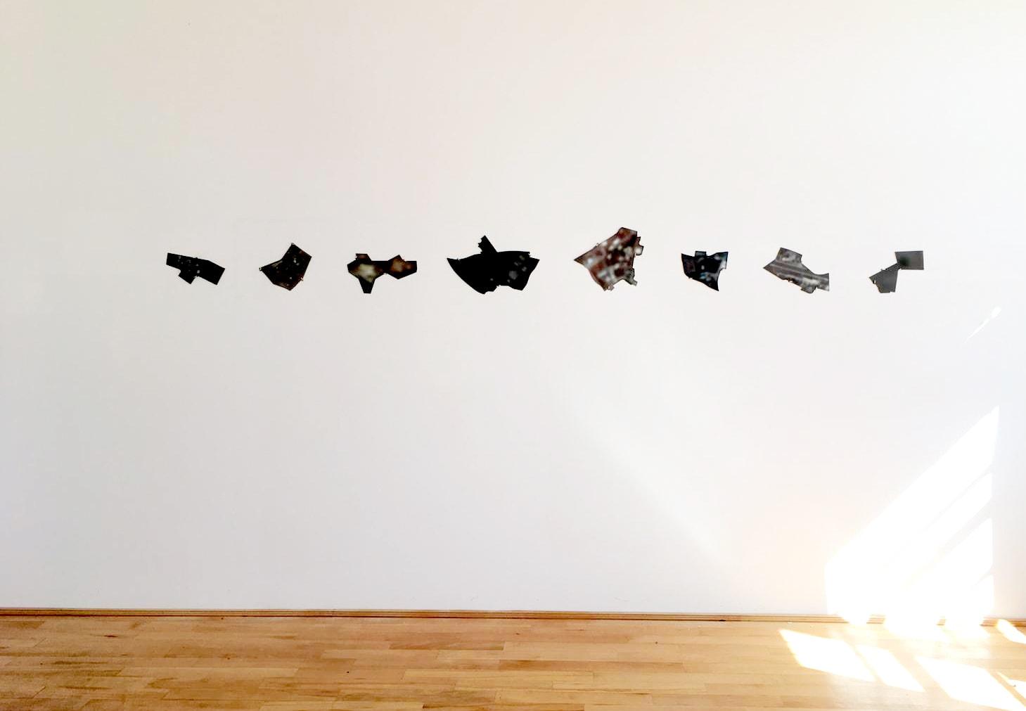 Baran Caginli, Untitle, 8 laser cut photographic prints on aluminum, 2020. Installation view. © Florin Bobu